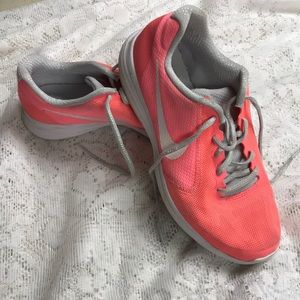 Girls coral Nike shoes